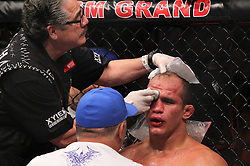 Las Vegas, NV - December 29, 2012: Junior Dos Santos gets advice from his corner during his main event bout at UFC 155 at MGM Grand Garden Arena in Las Vegas, Nevada.