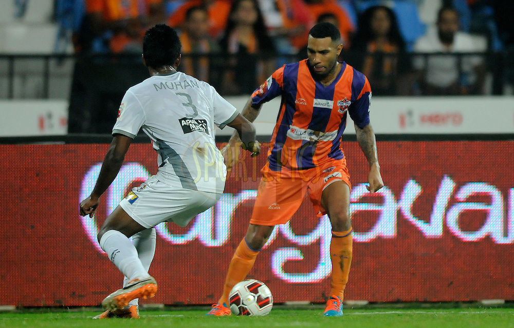 Jermaine Pennant of FC Pune Cityand Nallappan Mohanraj of Atletico de Kolkata in action during match 44 of the Hero Indian Super League between FC Pune City and Atletico de Kolkata FC held at the Shree Shiv Chhatrapati Sports Complex Stadium, Pune, India on the 29th November 2014.<br /> <br /> Photo by:  Pal Pillai/ ISL/ SPORTZPICS