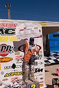 Doug Eichner (#1) holds up his ATV Riders.com $100.00 holeshot award.