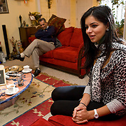Miss Michigan USA Rima Fakih of Dearborn won the Miss USA title Sunday. Lebanese American Rima Fakih, first made history when she became the first Arab American and Muslim American to win Miss Michigan USA. She is photographed at her home in  Dearborn, MI, Sunday, December 27, 2009. Fakih's family is Muslim but, also celebrates Christian holidays as her father's parents were Muslim and Christian. Her father Hussein Fakih is in the background.(Jeffrey Sauger)