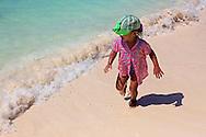 Small girl on the beach in Guadalavaca, Holguin, Cuba.