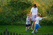 Joy Camp takes her sons, Scott, left, and Cory, right, on a walk through a field near their Maryland home.