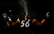PITTSBURGH - JANUARY 18: LaMarr Woodley #56 of the Pittsburgh Steelers spits water out of his mouth while being introduced before a game against the Baltimore Ravens during the AFC Championship Game on January 18, 2009 at Heinz Field in Pittsburgh, Pennsylvania. The Steelers defeated the Raves 23 to 14 to advance to Super Bowl XLIII. (Photo by Rob Tringali//) *** Local Caption *** LaMarr Woodley