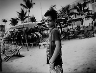 Young tough on the beach where he rents out jetskis.  Pattaya, Thailand.