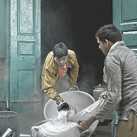 Two men make curd outside their store in Amritsar, Punjab, India.