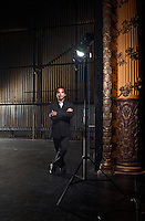Actor Jacob Rajan, founder of the Indian Ink Theatre Company, photographed on the bare stage of the St James Theatre, Wellington. The theatre contains distinctive, ornate pillars and opera-boxes. Jacob Rajan graduated from Toi Whakaari with a Diploma in Professional Drama (Acting) in 1994. http://www.indianink.co.nz  http://www.stjames.co.nz/