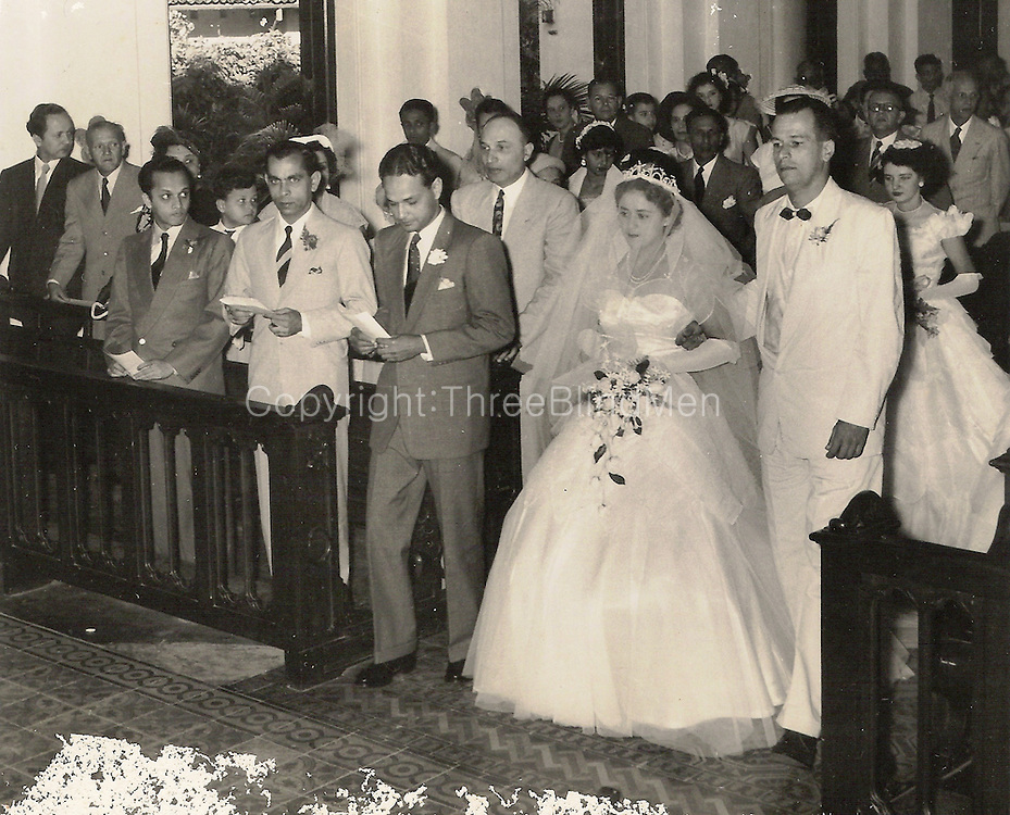Uncle Neville de la Motte giving away his sister Dagmar, at St Mary's Church Bambalapitiya, on the 8th November 1954.<br />