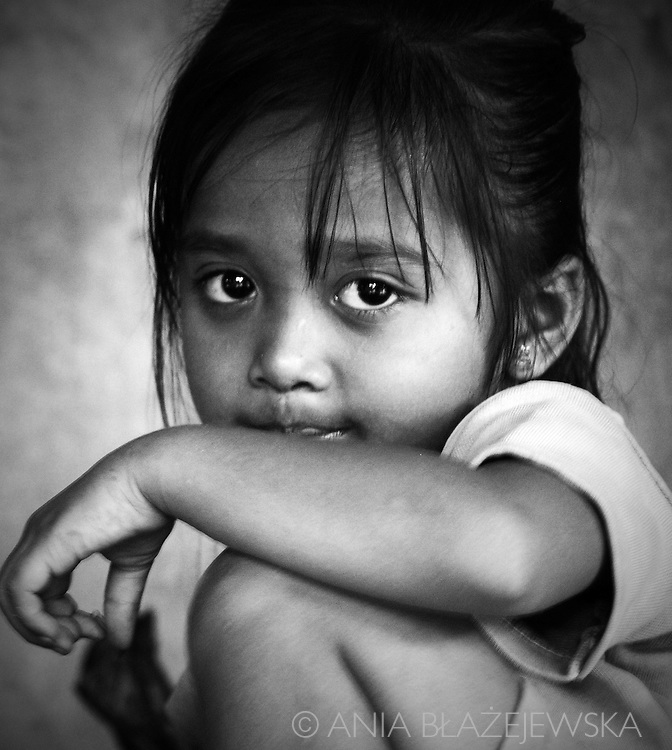 Indonesia, Bali. Portrait of a cute girl from Mas - a daughter of a local woodcarver.