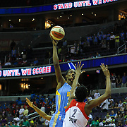 Chicago Sky Center SYLVIA FOWLES (34), Right, shoots over Washington Mystics Center MICHELLE SNOW (2) during the second half of an WNBA regular season basketball game between the Washington Mystics and the Chicago Sky Wednesday, July. 24, 2013 at The Verizon center in Washington DC.