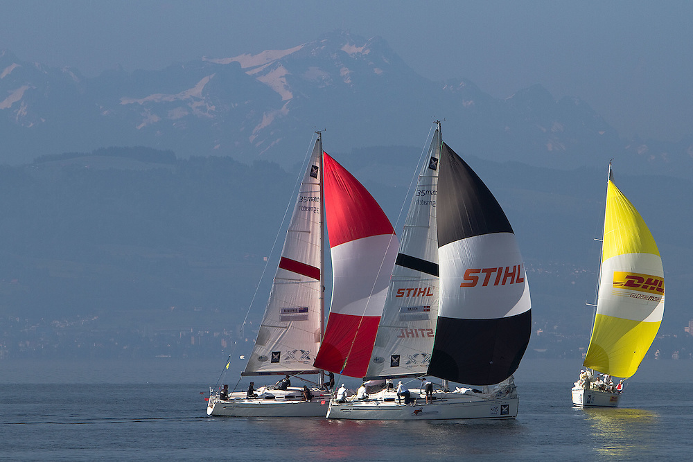 The Swiss Alps appear through the haze as crews practice for the quarter finals of Match Race Germany 2010. World Match Racing Tour. Langenargen, Germany. 23 May 2010. Photo: Gareth Cooke/Subzero Images/WMRT