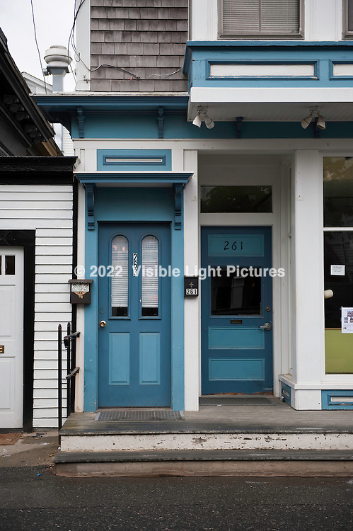 Blue doors on a white building
