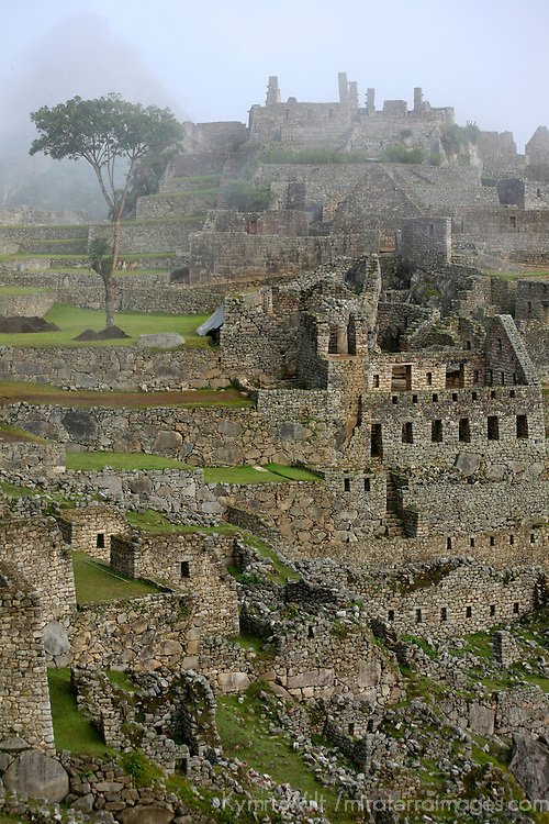 South America, Peru, Machu Picchu. The ancient citadel of Machu Picchu cloaked in mist.