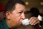 12 JANUARY 2007 - MANAGUA, NICARAGUA: HUGO CHAVEZ, President of Venezuela, drinks of cup of Nicaraguan coffee in Managua before he left Nicaragua to return to Venezuela. Chavez has promised massive amounts of aid  for Nicaragua including free and discounted oil and portable electric generating stations. Nicaragua is the second poorest country in the western hemisphere. Coffee is one of Nicaragua's leading exports. Photo by Jack Kurtz
