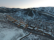 SHOT 3/2/17 6:34:48 PM - Aerial photos of Park City, Utah. Park City lies east of Salt Lake City in the western state of Utah. Framed by the craggy Wasatch Range, it's bordered by the Deer Valley Resort and the huge Park City Mountain Resort, both known for their ski slopes. Utah Olympic Park, to the north, hosted the 2002 Winter Olympics and is now predominantly a training facility. In town, Main Street is lined with buildings built primarily during a 19th-century silver mining boom that have become numerous restaurants, bars and shops. (Photo by Marc Piscotty / © 2017)