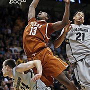 SHOT 2/26/11 4:36:22 PM - Texas' Tristan Thompson (#13) looses the ball while driving to the basket in front of Colorado's Levi Knutson (#24) and Andre Roberson (#21) during their regular season Big 12 basketball game at the Coors Events Center in Boulder, Co. Colorado upset the fifth ranked Texas 91-89. (Photo by Marc Piscotty / © 2011)