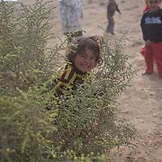 Bedouin kids play in their village called Aricha next to Mitspe Ramon. Photo by Oren Nahshon
