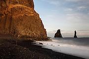 Basalt cliffs at sunset, at Reynisfjara beach, near Vik, Southern Iceland