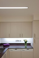 kitchen with flowers towel and lighting by deltalight