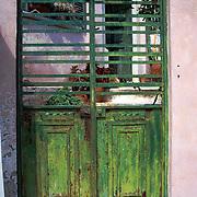 Oia, Santorini Island, Greece: green iron gate.