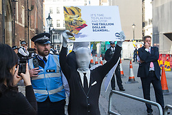 """St James, London, May 12th 2016. Protesters from transparency and accountability group One demonstrate demanding """"a new, global standard of transparency that could end the corruption that keeps people poor"""". PICTURED: A protester in a """"morph suit"""" outside the conference security cordon."""