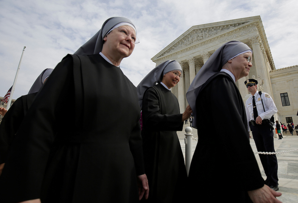 Nuns with Little Sisters of the Poor walk after Zubik v. Burwell, an appeal brought by Christian groups demanding full exemption from the requirement to provide insurance covering contraception under the Affordable Care Act, was heard by the U.S. Supreme Court in Washington March 23, 2016.      REUTERS/Joshua Roberts