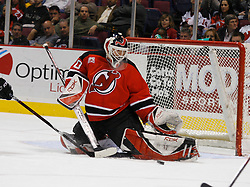 Mar 30, 2007; East Rutherford, NJ, USA; New Jersey Devils goalie Martin Brodeur (30) makes a save during the first period at Continental Airlines Arena in East Rutherford, NJ.