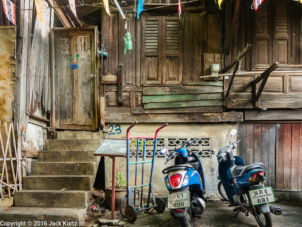 07 APRIL 2016 - BANGKOK, THAILAND: A 200 year old home in Mahakan Fort. The home, one of the original homes in the squatters' community in the fort, was built without nails using a wedging technique. The concrete base was added a few years ago. Mahakan Fort was built in 1783 during the reign of Siamese King Rama I. It was one of 14 fortresses designed to protect Bangkok from foreign invaders, and only of two remaining, the others have been torn down. A community developed in the fort when people started building houses and moving into it during the reign of King Rama V (1868-1910). The land was expropriated by Bangkok city government in 1992, but the people living in the fort refused to move. In 2004 courts ruled against the residents and said the city could take the land. The final eviction notices were posted last week and the residents given until April 30 to move out. After that their homes, some of which are nearly 200 years old, will be destroyed.       PHOTO BY JACK KURTZ