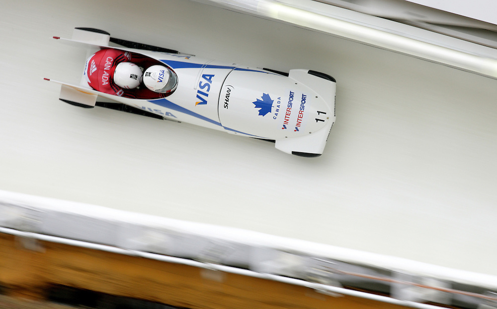 (November 21, 2009) Lyndon Rush and Lascelles Brown of Canada fly through the 'Shady' corner enroute to a 7th place finish in the two-man bobsled at  the Federation Internationale de Bobsleigh et de Togogganing (FIBT) two-man men's bobsled World Cup race at the Olympic Sports Complex in Lake Placid, New York.