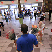 John luger sells flowers at John Dickinson High School  55th commencement exercises Saturday, June 06, 2015, at The Bob Carpenter Sports Convocation Center in Newark, Delaware.