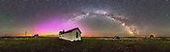 A 360&deg; panorama of the night sky and prairie landscape from the Visitor Centre and farmyard at the Old Man on His Back Prairie &amp; Heritage Conservation Area in southwest Saskatchewan. The Milky Way arches across the eastern sky from north to south, while an aurora display (faint to the naked eye) glows in an arch of green and magenta across the northern horizon. The pioneer house was built in the 1920s and this was a working ranch until the 1990s when the land was turned over to the Nature Conservancy of Canada to turn into a natural area to preserve the short grass prairie habitat. <br /> <br /> This a stitch of 8 segments, each a 1 minute untracked exposure at f/3.5 with the 15mm lens and ISO 4000 with the Canon 6D. Stitched with PTGui software. I shot these May 18, 2015.