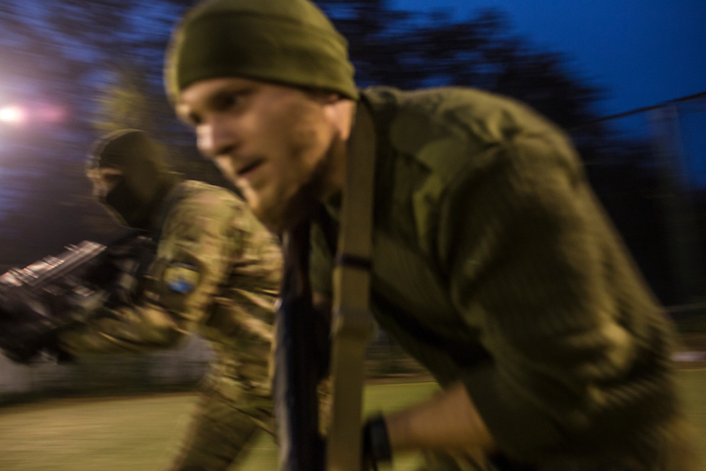 Members of the Azov Battalion, a pro-Ukraine militia, demonstrate a training exercise at the group's base on Wednesday, October 15, 2014 in Urzuf, Ukraine. Photo by Brendan Hoffman, Freelance