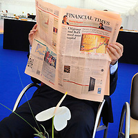 Financial Times reader during a break at the St Gallen Symposium, an annual event, bringing global business leaders together with elite students from business schools from around the world, hosted by St Gallen University, which has Switzerland's most important business school.