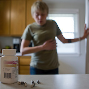 """New treatments have helped Emily Schaller, a 27-year-old cystic fibrosis patient, from Trenton, MI, recently run a half marathon. She takes 40 capsules of Pancrelipase each day to help digest nutrients from food. She also wears her """"smart vest,"""" which shakes her chest to help break up mucous in her lungs and inhales from her nebulizer on Tuesday, April 21, 2009. She wears the vest for 25 minutes at least once every day. She inhales Pulmozyme for 7 minutes once and inhales hyper-tonic saline (salt water) twice every day."""