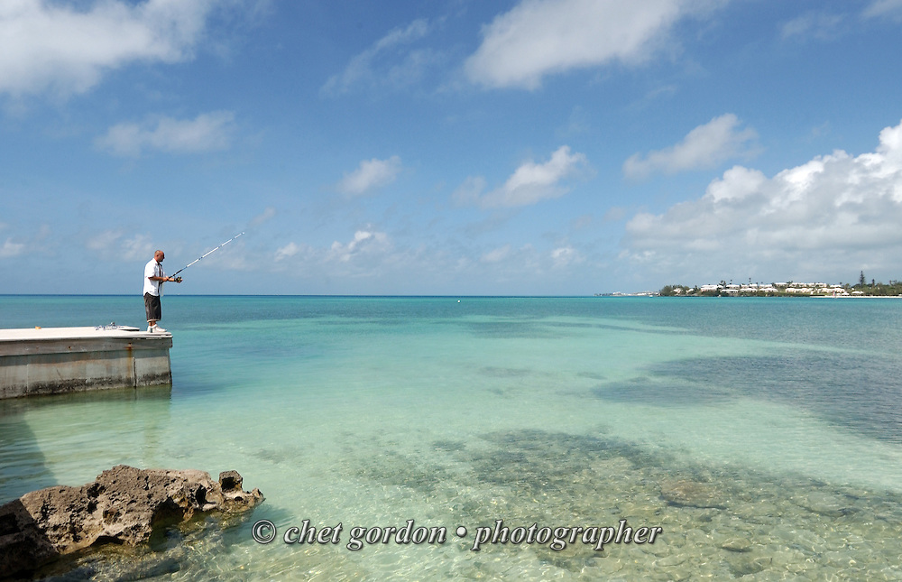 A man fishes off a pier at the former 9 Beaches Resort in Sandy's Parish, Bermuda on Wednesday, July 27, 2011. The resort is expected to be refurbished in 2012.