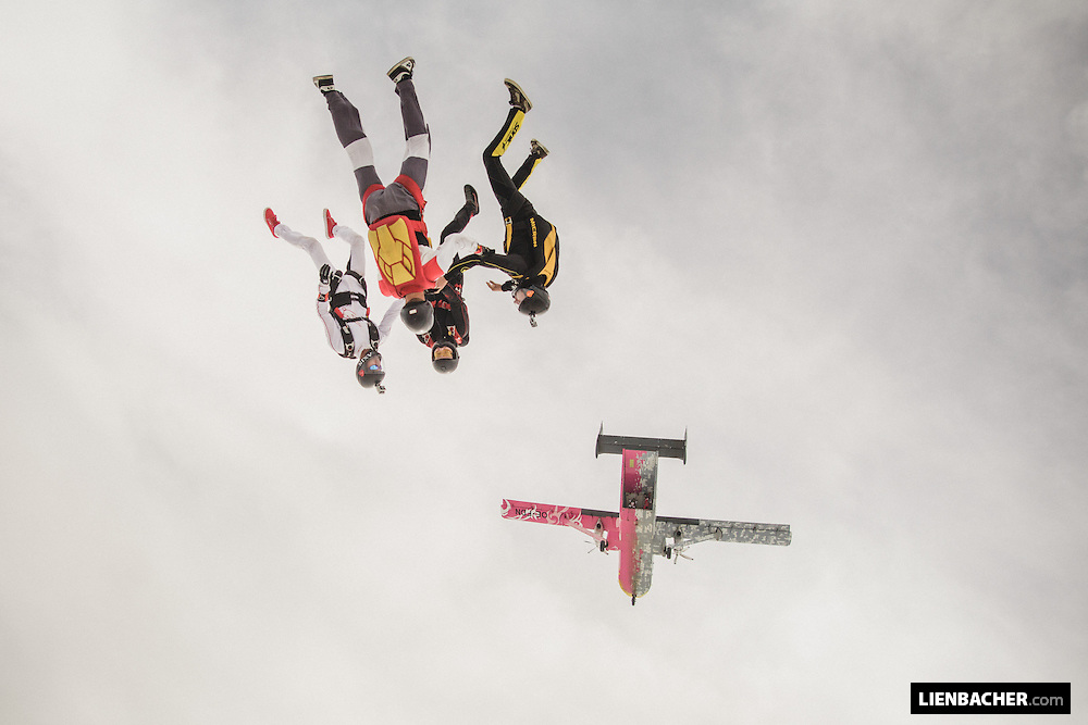 four skydivers performing a headdown exit from the famous Pink Skyvan over Klatovy