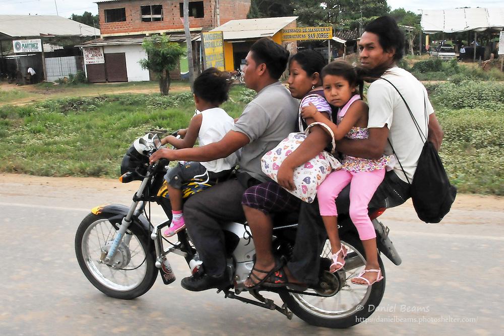 Five people on one motorcycle near Guarayos, Santa Cruz, Bolivia