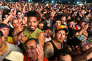 HAVANA, CUBA - MARCH 25, 2016: Concertgoers await a free performance by The Rolling Stones at Ciudad Deportiva on March 25, 2016 in Havana, Cuba. The Rolling Stones performance is the first by a major international rock band in Cuba, coming days after a historic visit by President Barack Obama of the United States, and a game between the Tampa Bay Rays and the Cuban National Team at Estadio Latinoamericano. The Cuban government banned rock music on Cuban state TV and radio following the Cuban the revolution, and nearly a half-million people are in attendance to be part of the historic event. (Photo by Jean Fruth)