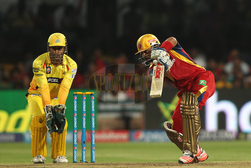Royal Challengers Bangalore captain Virat Kohli drives a delivery through the covers during match 20 of the Pepsi IPL 2015 (Indian Premier League) between The Royal Challengers Bangalore and The Chennai Superkings held at the M. Chinnaswamy Stadium in Bengaluru, India on the 22nd April 2015.<br /> <br /> Photo by:  Shaun Roy / SPORTZPICS / IPL