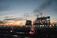 """By the railway station in downtown Belgrade, the temporary citizens-from-nowhere are living their nomad existences in the the rubble of the so-called Belgrade """"Waterfront"""" construction project."""