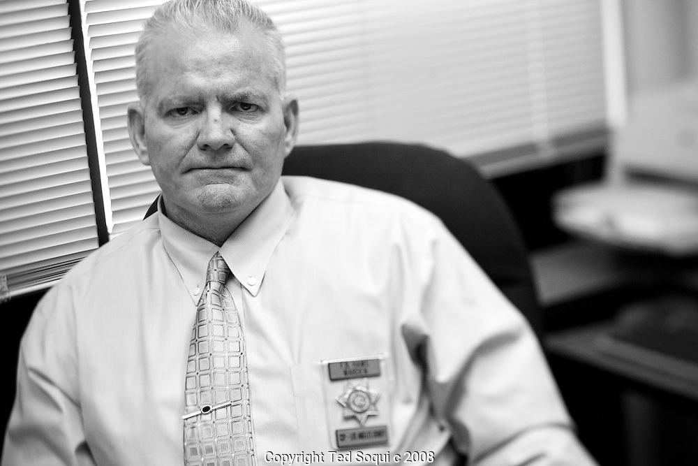 Brian Haws, Warden of the California State Prison, Los Angeles County inside his office...