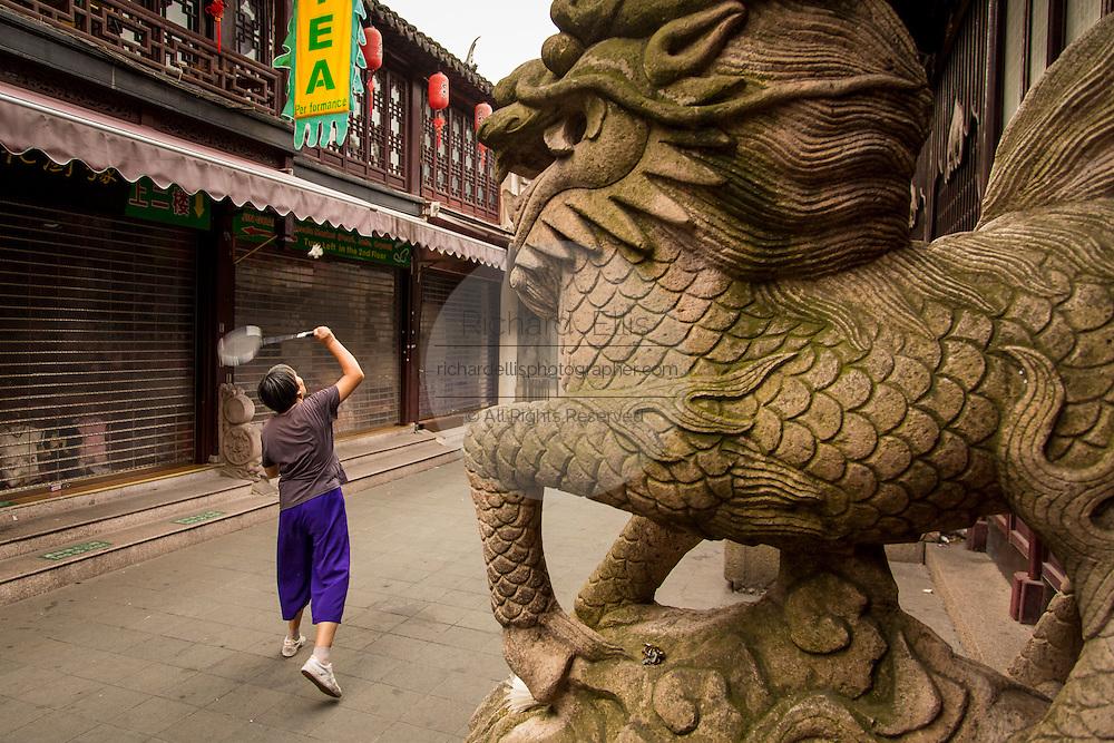 Chinese people play badminton in the Yu Gardens bazaar Shanghai, China