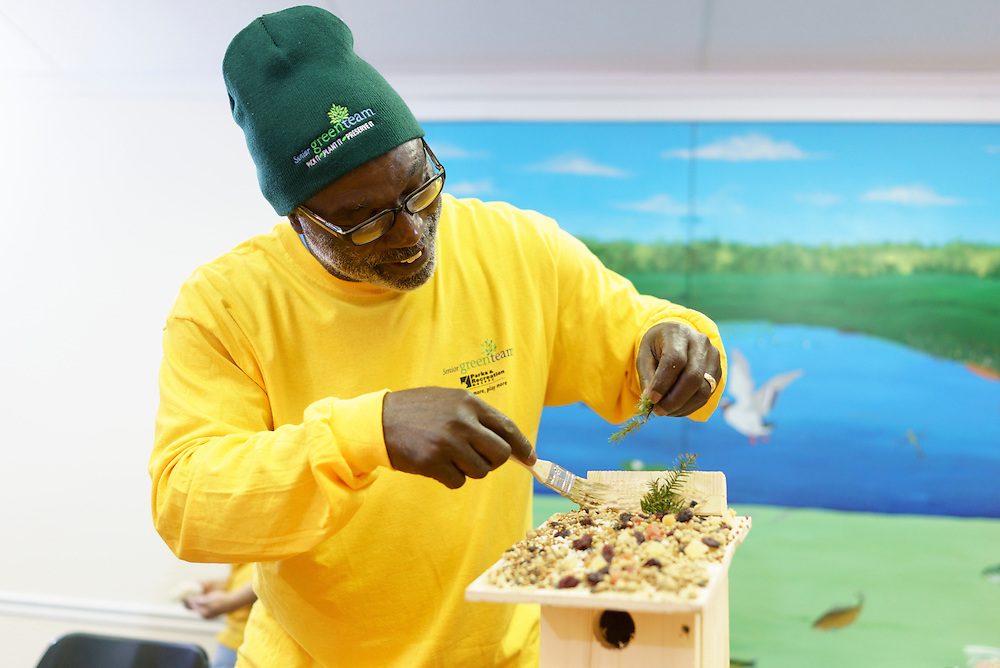 Upper Marlboro, Maryland - January 03, 2017: Arthur Harris, a members of the Senior Green Team builds and decorates a birdhouse at the Watkins Park Nature Center in Upper Marlboro, Md., Tuesday January 3, 2017. The group meets the first Tuesday morning of each month and works on nature beautification projects like trail maintenance, tree planting, clean ups, and, educational outings. <br /> <br /> CREDIT: Matt Roth