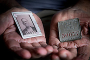 Pete Marovich Sr. holds his father, Tom Marovich's, Jones and Laughlin Steel Company ID card, which was cut in half when he retired, and ID badge.