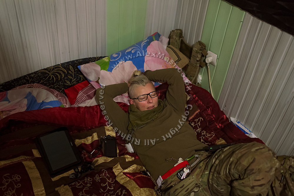 Julia Paevska is relaxing on her bed inside a small base near the Bakhmut-Debaltseve highway, in Ukraine's conflict zone.