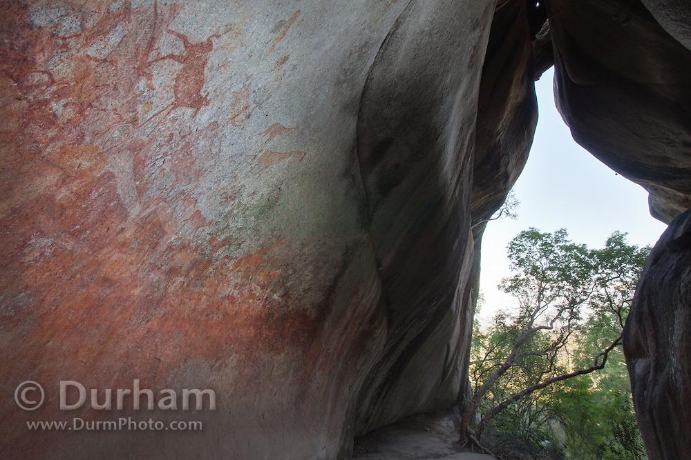 San bushman rock paintings, estimated at around 2000 years old, in Nswatugi Cave in Matobo National Park, Zimbabwe.