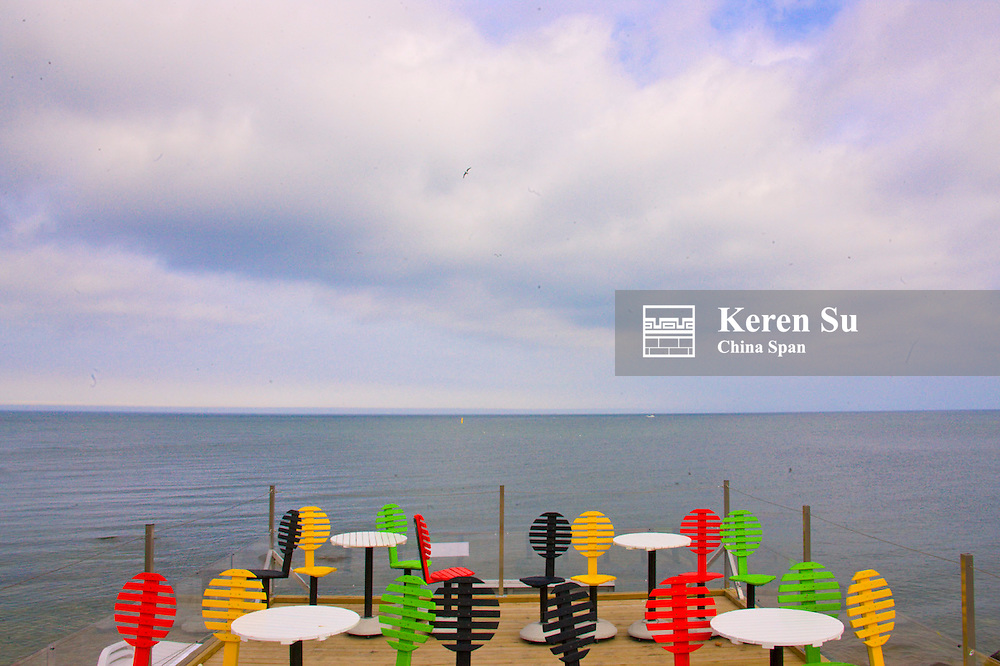 Colorful dining table and chirs on the dock, Visby, Gotland island, Sweden