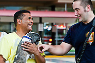 A resident of Capitol Park Towers thanks a fireman for rescuing him and his dog from a fire.