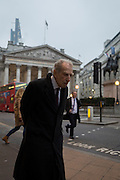An tired-looking elderly gentleman stoops as he walks past the Bank of England, on 9th February 2017, in the City of London, England.