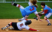 (Clockwise from bottom) David Douglas runner Nicole Overturf upends Madison's Stephine Catt at second base as her teammate Maggie Wilson attempts pull in the loose ball. Overturf safely made the steal with no serious injury to any player.