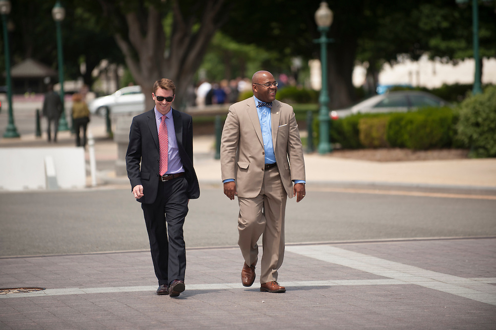 """Senator William Maurice """"Mo"""" Cowan (D-MA) walks to an appointment on Capitol Hill with a staff member. (NOTE: Cowan's office refused to identify the staffer)"""